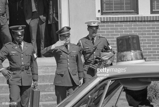 Lt William Calley Jr salutes as he is escorted from the courthouse here on March 31st after being sentenced to life imprisonment at hard labor for...