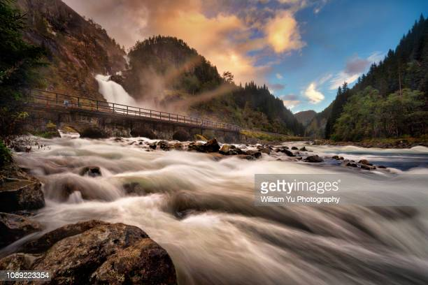 låtefossen waterfall - swift river stock photos and pictures