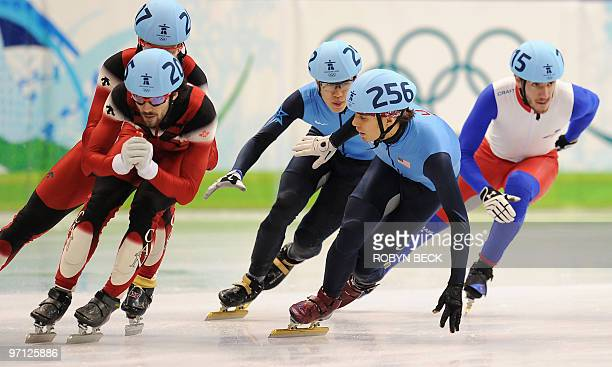 Lto R Canada's Charles Hamelin US Apolo Anton Ohno and France's Thibaut Fauconnet compete in the Men's 5000 m relay shorttrack final at the Pacific...