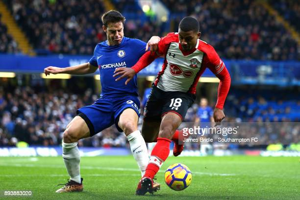 LtoR Cesar Azpilicueta takes on Mario Lemina of Southampton during the Premier League match between Chelsea and Southampton FC at Stamford Bridge on...