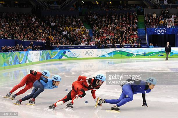 LtoR China's Jialiang Han US Apolo Anton Ohno Canada's Charles Hamelin and South Korea's SiBak Sung compete in the Men's 1000m shorttrack semifinal...