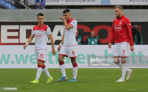 LtoR Erik Thommy Alfredo Morales and Andre Hoffmann of Duesseldorf leave the pitch after the Bundesliga match between SC Paderborn 07 and Fortuna...