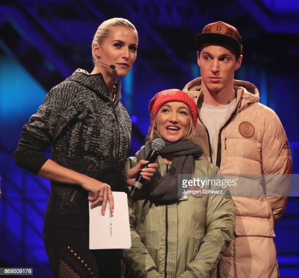 LtoR Lena Gercke, Aljona Savchenko and Bruno Massot attend the presentation of the outfit for German athletes competing in the upcoming Olympic Games...
