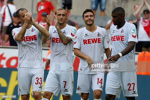 LtoR Matthias Lehmann Marcel Risse Jonas Hector and Anthony Modeste of Cologne celebrate in front of supporters after the Bundesliga match between 1...
