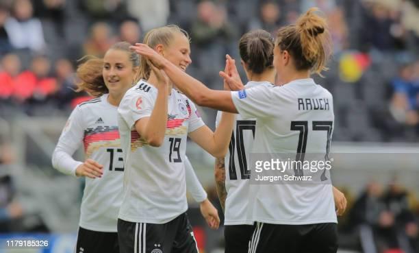 LtoR Sara Daebritz, Klara Buehl and Felicitas Rauch of Germany celebrate during the UEFA Women's European Championship 2021 qualifier match between...