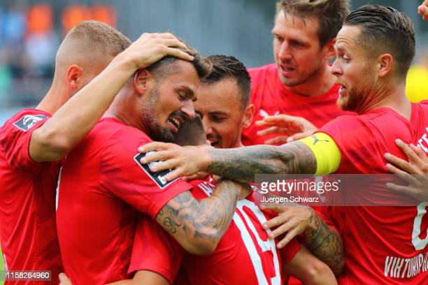 LtR Albert Bunjaku, Simon Handle and Mike Wunderlich of Cologne celebrate during the 3. Liga match between FC Viktoria Koeln and Chemnitzer FC at...