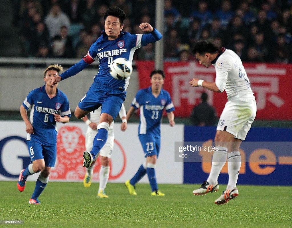 Lu Bofei #9 of Jiangsu Sainty shoots the ball during the AFC Champions League match between Jiangsu Sainty and Buriram United at Nanjing Olympic Sports Center Stadium on April 2, 2013 in Nanjing, China.