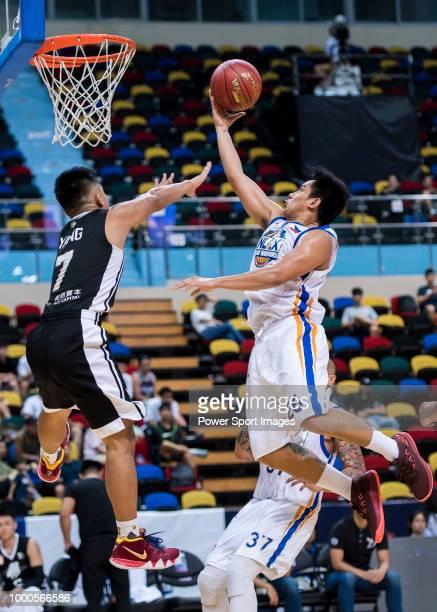 Lu Chih Wang of Formosa Dreamers tries to score against the Xinjiang Guanghui Flying Tigers during Summer Super 8 game between Xinjiang Guanghui...