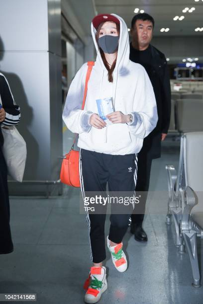Lu Han appears at Chengdu airport with his girlfriend Guan Xiaotong on 26th September 2018 in ChengduSichuan China