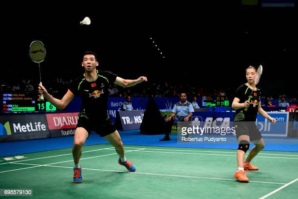 Lu Kai and Huang Yaqiong of China compete against Bodin Isara and Savitree Amitrapai of Thailand during Mixed Doubles Round 1 match of the BCA...