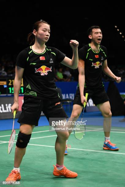 Lu Kai and Huang Yaqiong of China reacts against Bodin Isara and Savitree Amitrapai of Thailand during Mixed Doubles Round 1 match of the BCA...