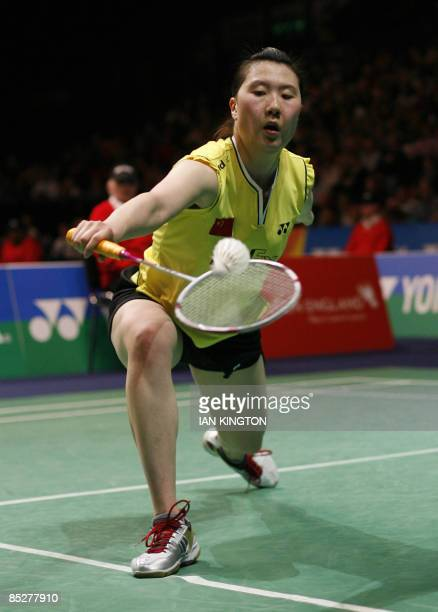 Lu Lan of China plays in her women's singles quarter final match against Jiang Yanjiao of China during All England Open Badminton Championships at...