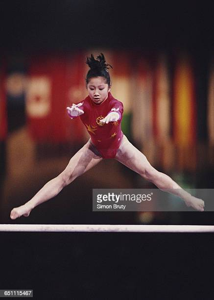 Lu Li of China performs during the Women's Uneven Bars event on 1 October 1992 during the World Artistic Gymnastics Championships at the Palais...