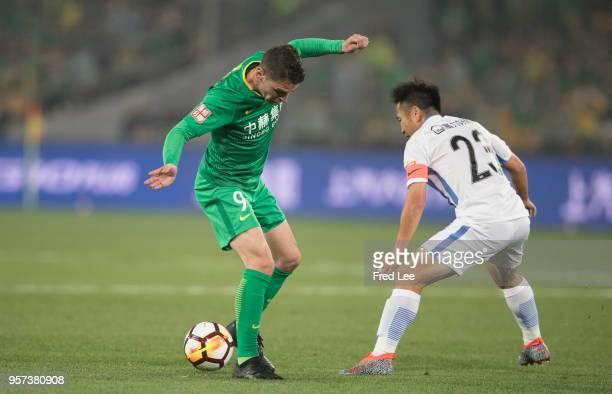 Lu Lin of Guangzhou RF and Soriano of Beijing Guoan in action during 2018 China Super League match between Beijing Guoan and Guangzhou RF at Beijing...