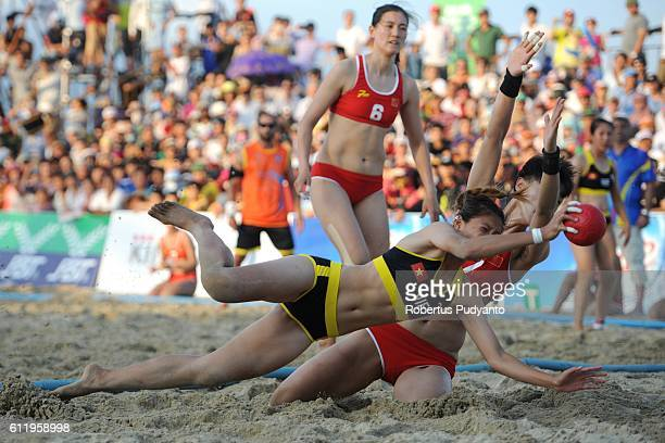 Lu Ngoc Trinh of Vietnam plays a shoot during Beach Handball Women's final match against China on day nine of the 5th Asian Beach Games 2016 at My...