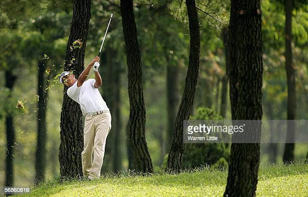 Lu WeiChih of Chinese Taipei plays his second shot out of the trees on the sixth hole during the first round of the Maybank Malaysian Open 2006 at...