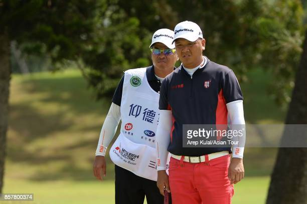 Lu Weichih of Taiwan in action during round one for the Yeangder Tournament Players Championship at Linkou lnternational Golf and Country Club on...