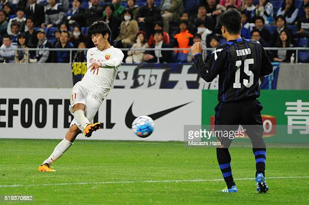 Lu Wenjun of Shanghai SIPG scores the second goal during the AFC Champions League Group G match between Gamba Osaka and Shanghai SIPG FC at the Suita...