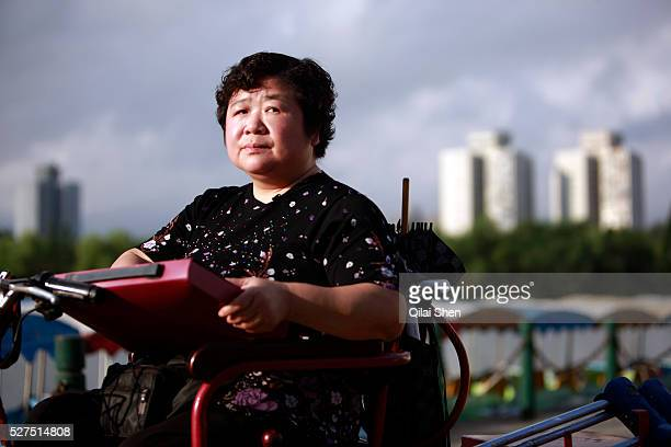 Lu Yafang an investor who claimed that she lost her life saving of 100000 RMB to investment schemes promoted by the local government photographed in...