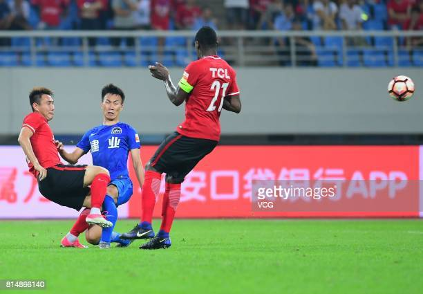 Lu Yao of Liaoning Whowin and Ke Zhao of Henan Jianye compete for the ball during the 17th round match of 2017 Chinese Football Association Super...