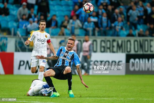 Lua of Gremio battles for the ball against Marcelo Palau of Guarani during the match Gremio v Guarani as part of Copa Bridgestone Libertadores 2017...