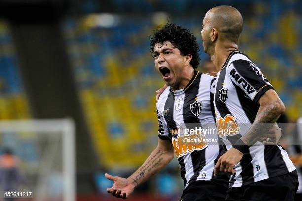 Luan and Diego Tardelli of Atletico Mineiro celebrate a scored goal against Fluminense during the match between Fluminense and Atletico Mineiro for...