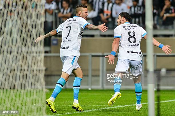 Luan and Giuliano of Gremio celebrates scoring a goal against Atletico MG during a match between Atletico MG and Gremio as part of Brasileirao Series...
