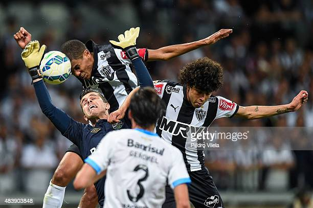 Luan and Leonardo Silva of Atletico MG and Marcelo Grohe and Erazo of Gremio battle for the ball during a match between Atletico MG and Gremio as...