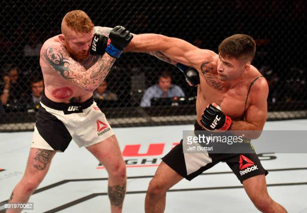 Luan Chagas of Brazil punches Jim Wallhead of England in their welterweight bout during the UFC 212 event at Jeunesse Arena on June 3 2017 in Rio de...