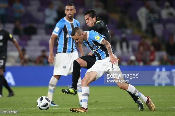 Luan De Jesus Vieira of Gremio in action against Jorge Hernandez of Pachuca during the 2017 FIFA Club World Cup semi-final soccer match between...