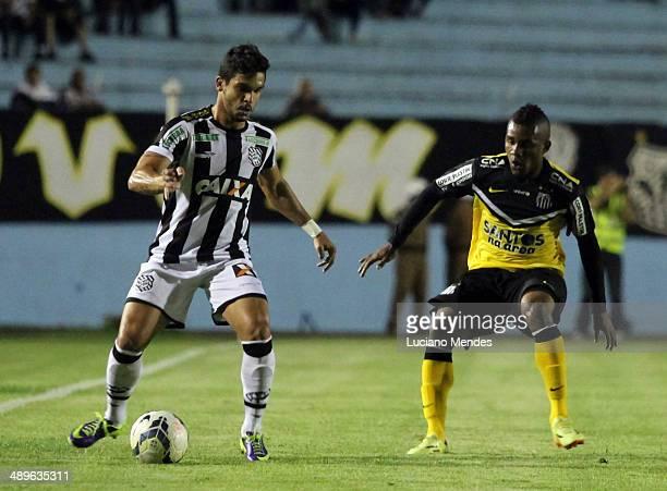Luan Figueirense babe Cicero of Santos in Series A Brasileirao 2014 at Cafe Stadium on May 11 2014 in Londrina Brazil