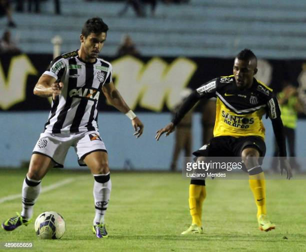 Luan Figueirense drives the ball in play against Zeca on Santos in Series A Brasileirao 2014 at Cafe Stadium on May 11, 2014 in Londrina, Brazil.