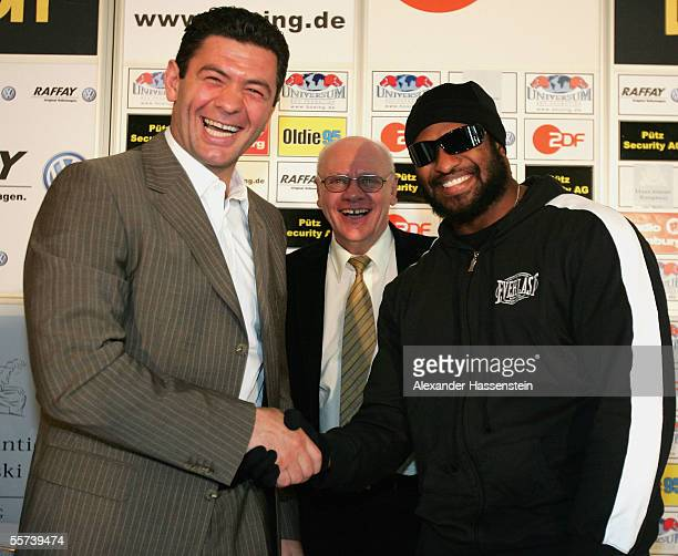 Luan Krasniqi of Germany and Lamon Brewster of the USA pose with promoter KlausPeter Kohl during the press conference for the upcoming WBO...