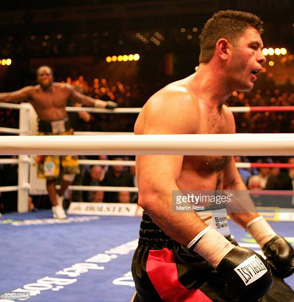 Luan Krasniqi of Germany is seen on his knees after the first knock down by Lamon Brewster of the USA during their WBO Heavyweight Championship Fight...