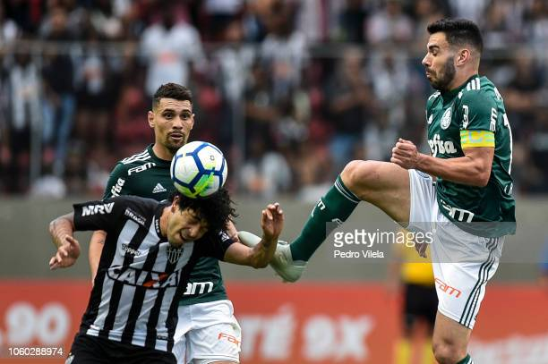Luan of Atletico MG and Bruno Henrique of Palmeiras battle for the ball during a match between Atletico MG and Palmeiras as part of Brasileirao...