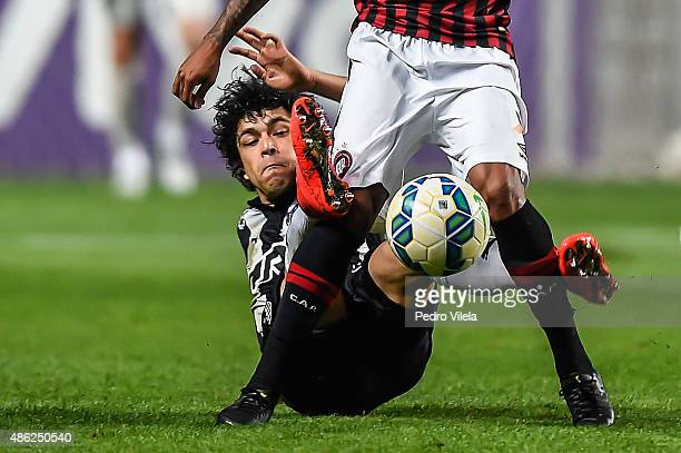 Luan of Atletico MG and Ewandro of Atletico PR battle for the ball during a match between Atletico MG and Atletico PR as part of Brasileirao Series A...