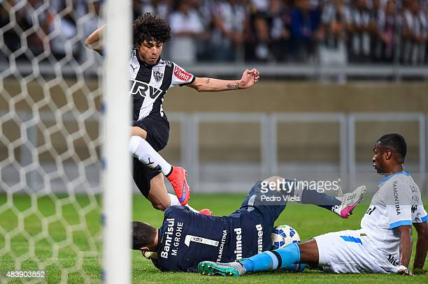 Luan of Atletico MG and Marcelo Grohe and Erazo of Gremio battle for the ball during a match between Atletico MG and Gremio as part of Brasileirao...