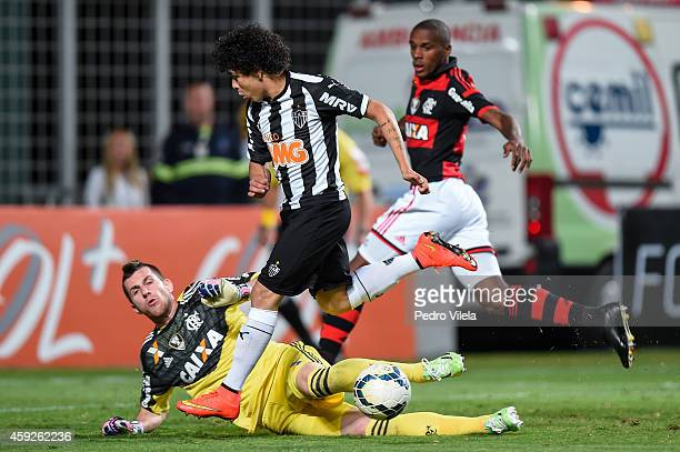 Luan of Atletico MG and Paulo Victor of Flamengo battle for the ball during a match between Atletico MG and Flamengo as part of Brasileirao Series A...