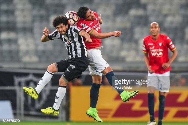 Luan of Atletico MG and Zenteno of Jorge Wilstermann battle for the ball during a match between Atletico MG and Jorge Wilstermann as part of Copa...