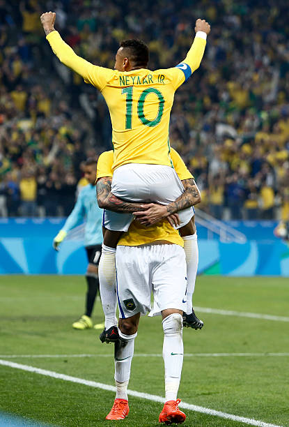 TOPSHOT - Luan of Brazil (Back) celebrates his goal with teammate Neymar  scored against 226fb568713a8