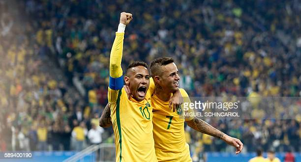 Luan of Brazil celebrates his goal with teammate Neymar scored against Colombia during their Rio 2016 Olympic Games men's football quarterfinal match...