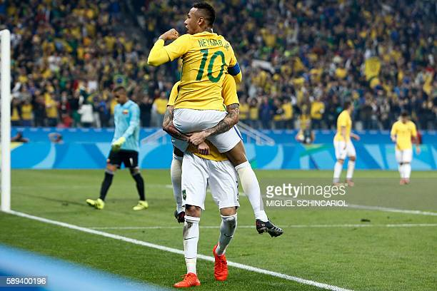 Luan of Brazil celebrates his goal with teammate Neymar scored against  Colombia during their Rio 2016 73320480e4549