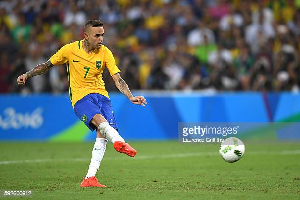 Luan of Brazil takes his penalty in the shoot out during the Men's Football Final between Brazil and Germany at the Maracana Stadium on Day 15 of the...