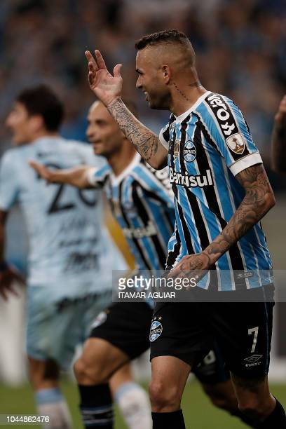 Luan of Brazil's Gremio celebrates after scoring against Argentina's Atletico Tucuman during their Copa Libertadores 2018 football match held at the...