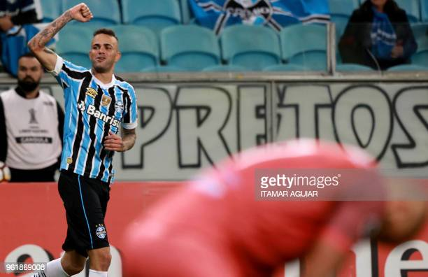 Luan of Brazil's Gremio celebrates after scoring against Uruguay's Defensor Sporting during their Copa Libertadores 2018 football match held at the...