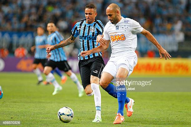 Luan of Gremio battles for the ball against Bruno Rodrigo of Cruzeiro during the match Gremio v Cruzeiro as part of Brasileirao Series A 2014 at...