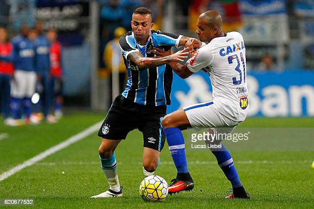 Luan of Gremio battles for the ball against Edimar of Cruzeiro during the match Gremio v Cruzeiro as part of Copa do Brasil SemiFinals 2016 at Arena...
