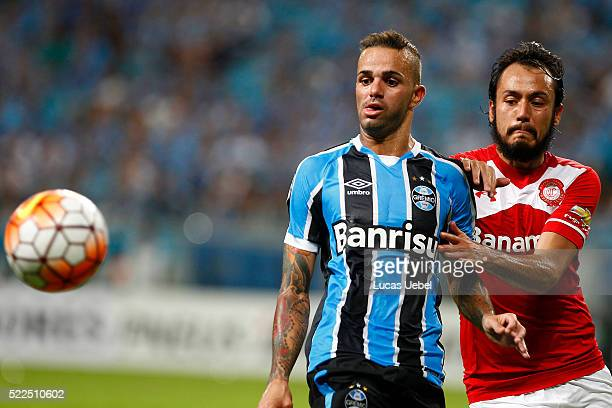 Luan of Gremio battles for the ball against Gerardo Flores of Toluca during the match Gremio v Toluca as part of Copa Bridgestone Libertadores 2016...