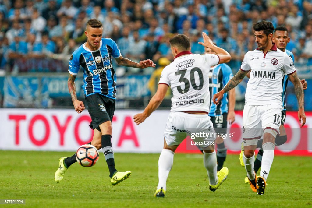 NOVEMBER 22 - Luan of Gremio battles for the ball against Ivan Marcone of Lanus during the match between Gremio and Lanus, part of Copa Bridgestone Libertadores 2017 Final, at Arena do Gremio on November 22, 2017, in Porto Alegre, Brazil.