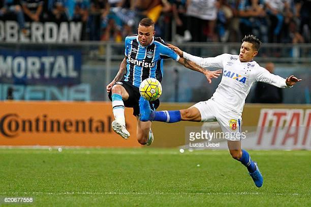 Luan of Gremio battles for the ball against Lucas Romero of Cruzeiro during the match Gremio v Cruzeiro as part of Copa do Brasil SemiFinals 2016 at...